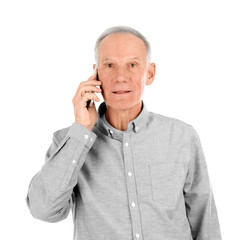 Attractive mature man talking on phone against white background