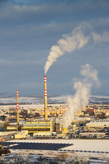 coal power plant with smoking chimneys and solar panels, ecological and outdated way of getting electricity. Air pollution