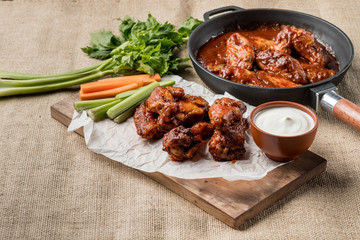 Buffalo chicken wings cooking. Food background.