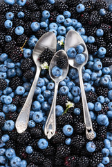 Blueberry and blackberry background. Close up. Top view. High resolution product.