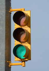 Green light illuminated on stop and go traffic light signal