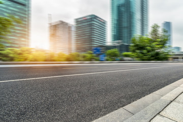 Empty asphalt road through modern city in Shanghai, China.