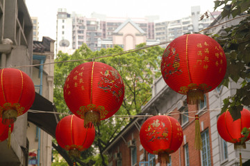Red Lanterns Hanging Over a Hong Kong Street. Chinese New Year is celebrated with hanging red lanterns in the central district of Hong Kong.