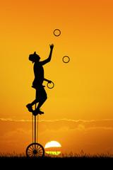juggler at sunset