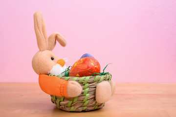 easter bunny in basket with egg