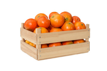 Fresh mandarins in wooden box
