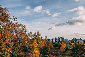 autumn view of residential area with high-rise buildings in Vilnius, Pilaite. BLue sky with soft clouds