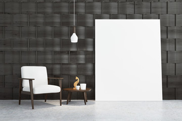 Gray room with a white armchair and a poster