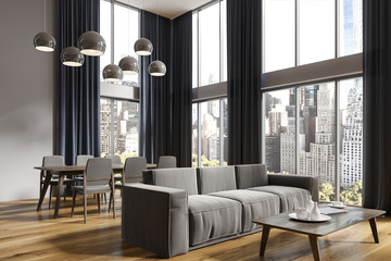 Panoramic gray living room and dining room corner
