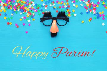 Purim celebration concept (jewish carnival holiday) with funny mustache glasses. Top view