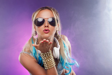 Send kiss. Young fashionable girl in disco style.