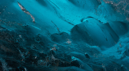 Close up of blue ice forms in ice cave under glacier in Iceland