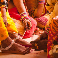 Bride feet coloring ceremony, a Hindu wedding ritual, during an Indian marriage.