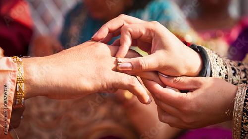 Indian couple exchanging their wedding rings during a Hindu Ring