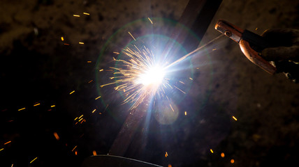 Sparks from welding at the construction site