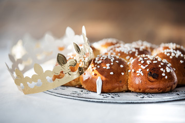 Swiss sweet bread with a golden paper crown and hidden miniature of king baked traditionally in Switzerland for Three Kings Day on January 6