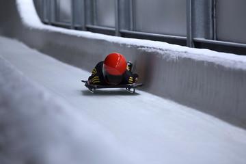 Foto op Plexiglas Wintersporten skeleton bob sled in ice channel