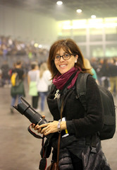 very beautiful female photographer at live concert