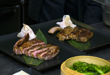 Flat steak cooked rare and sliced open on plate