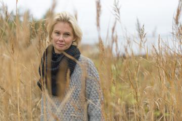 Woman in wheat field in Norrpada, Sweden