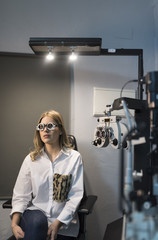Woman wearing trial frame at ophthalmologist