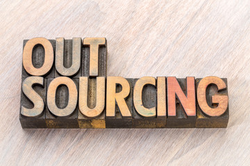 outsourcing word abstract in wood type