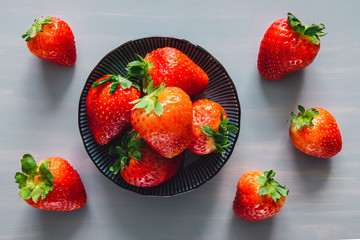 Bowl of Strawberries on Grey Table