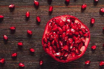 Pomegranate on Dark Table