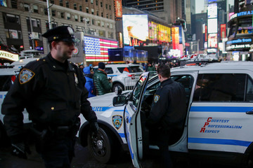 NYPD officers walk in Times Square ahead of New Year's Eve celebrations in Manhattan