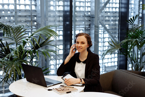 Business Portrait The Woman In A White Blouse And Black Jacket Talks On