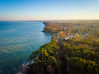 Wall Mural - Aerial view of Baltic sea coast with small settlement