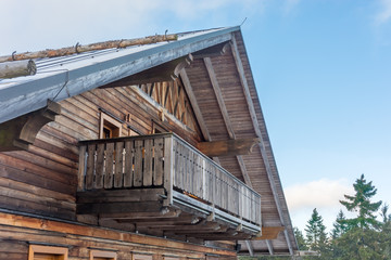 Detail of a rustic mountain hut made of wooden facade in the Alps