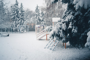 Winter day in a snowfall in the town.