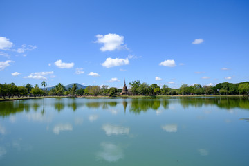 Sukhothai Historical Park with huge lake, reflection, mountain and blue sky