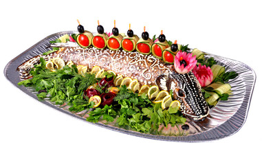 Baked pike served with vegetables