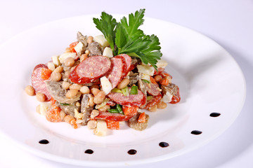 Salad of sausages, ham and beans