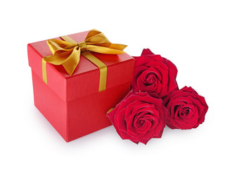 Red classic gift box with golden satin bow and bouquet of roses