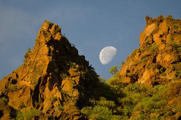 Moon over a cliff at dawn. Barranco de Guayadeque Natural Monument. Agüimes. Gran Canaria. Canary Islands. Spain.