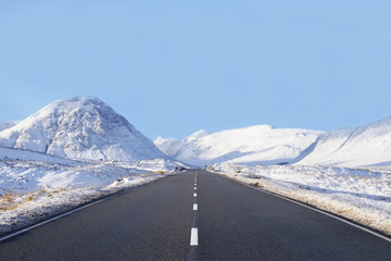 Empty wide road blank horizon in Glencoe Scotland