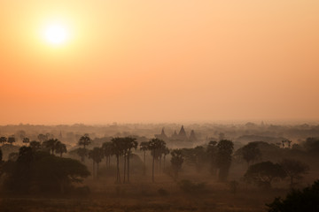 Sunrise over misty plain and ancient temples in Bagan, Myanmar (Burma).