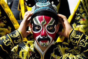 A Beijing Opera performer prepares for a countdown event celebrating the new year in Beijing