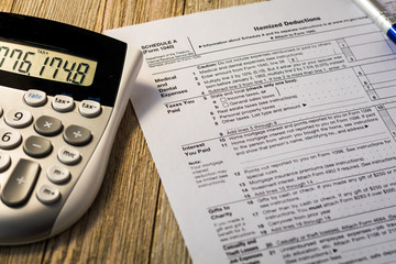 Tax reform concept with tax preparation forms for standard deductions on wooden board
