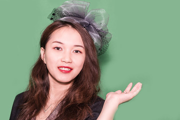 The portrait of a young oriental girl with fascinator