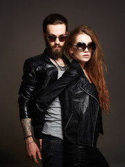 fashion beautiful couple in sunglasses and leather
