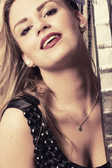Material girl retro-style photograph. Close up portrait of young woman smiling