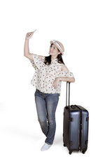 Caucasian woman taking picture with a suitcase