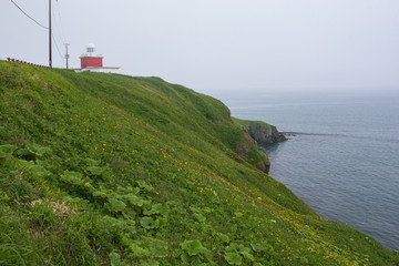 Lighthouse on the rocky cliffs of Kiritappu cape, Hokkaido, Japan