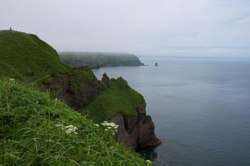 Green and steep rocky cliffs of Kiritappu cape, Hokkaido, Japan