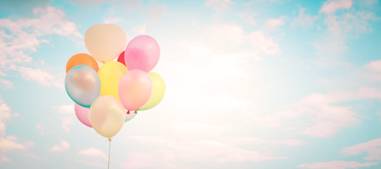 Vintage multicolor balloons with done with a retro instagram filter effect on blue sky. Ideas for web banner background. Love in summer and valentine, wedding honeymoon concept.