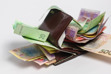 Ukrainian hryvnia banknotes in denominations in black purse isolated